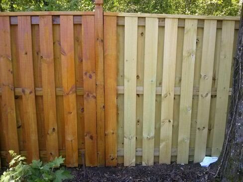 Fence staining in process. New wooden fence installation. This photo was taken in Mesquite, TX.